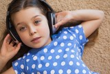 High angle portrait of a little girl listening music
