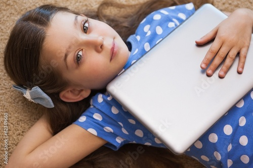 High angle portrait of a little girl with digital tablet