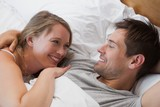 Close-up of a happy relaxed couple in bed