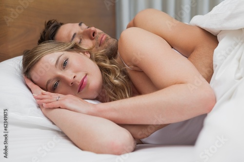 Portrait of a loving relaxed couple in bed