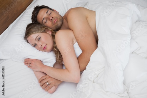 High angle view of a loving relaxed couple in bed