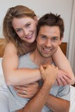 Close-up of loving relaxed couple in bedroom