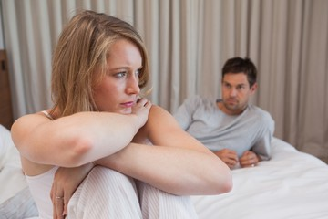 Couple not talking after an argument in bed