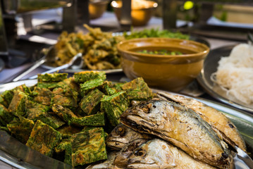 Thai traditional food with fried mackerel and vegetable omelet