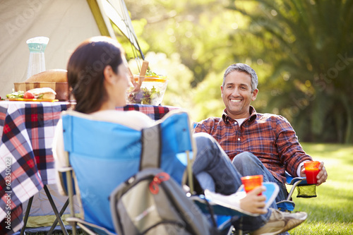 Couple Enjoying Camping Holiday In Countryside - 62350022