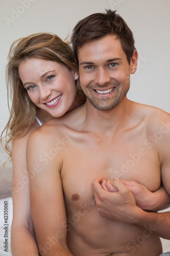 Portrait of loving relaxed couple in bedroom