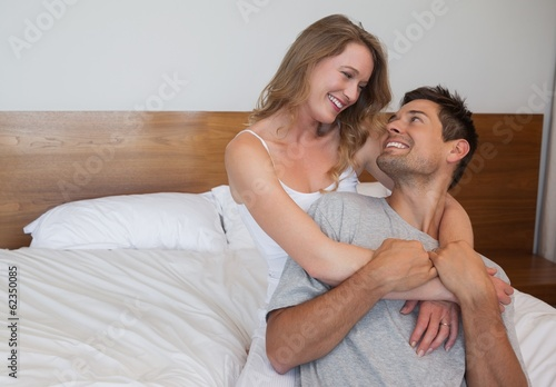 Loving relaxed couple in bedroom