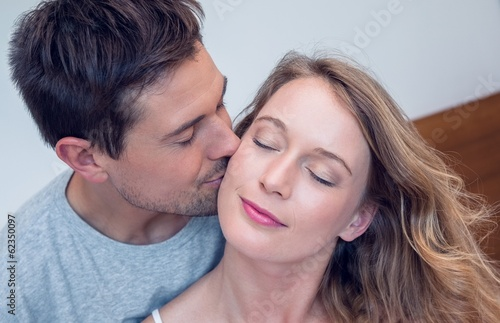 Close-up of a loving man kissing woman