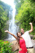Hawaii tourist people happy by waterfall
