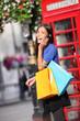 London woman talking happy smart phone shopping