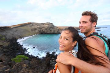 Hiking - travel couple tourist on Hawaii hike