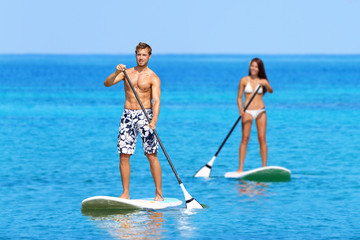 Paddleboard beach people on stand up paddle board