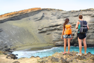 Hikers - travel couple tourists hiking on Hawaii