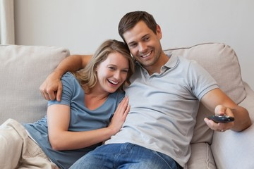 Couple watching tv on sofa in the living room