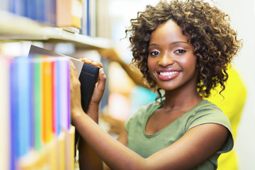 african college girl looking for book in library