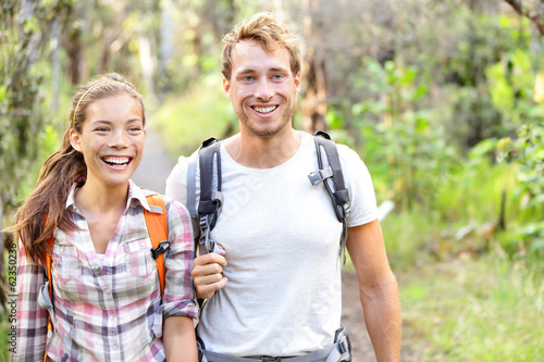Hiking - hikers walking happy in forest
