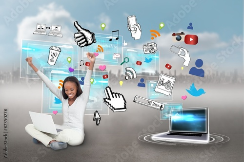 Cheering girl using laptop with app icons