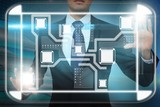 Businessman touching interface
