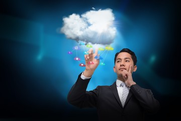 Asian businessman pointing to cloud and app icons