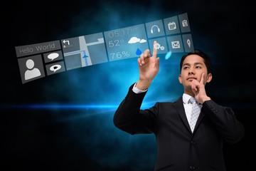 Asian businessman pointing to app menu