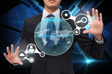 Businessman touching earth interface with graphics