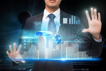 Businessman touching interface with graphics