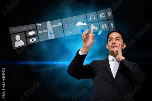 Asian businessman pointing to app menu