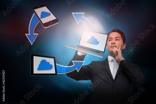 Asian businessman pointing to cloud computing cycle
