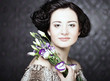 beautiful woman with lilac  flower