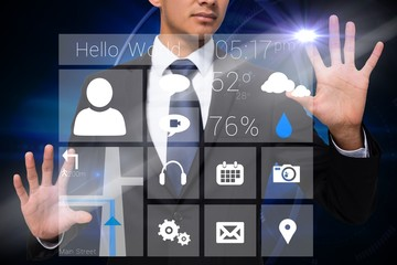 Businessman touching app interface with graphics
