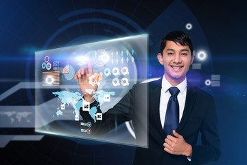 Happy businessman touching interface
