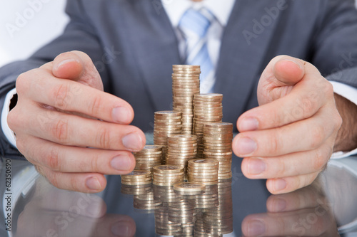Businessman Taking Care Of Coins