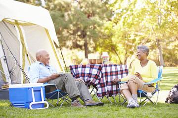 Senior Couple Enjoying Camping Holiday In Countryside