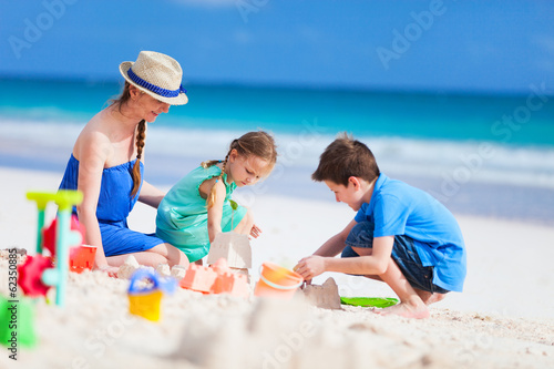 Mother and kids playing at beach