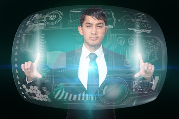 Serious businessman touching interface