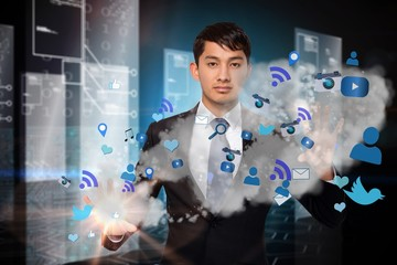 Serious businessman touching apps in cloud