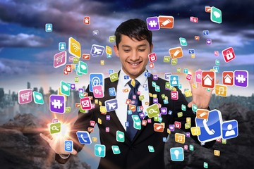 Smiling businessman touching apps