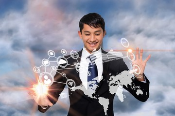 Smiling businessman touching earth interface
