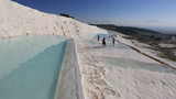 famous place travertine terraces and pool in Pamukkale at Turkey