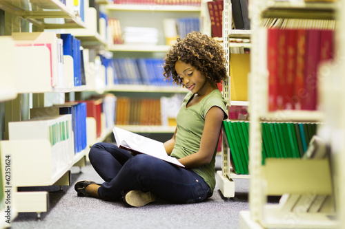 female african american student sitting on the floor