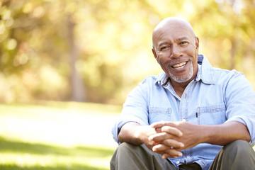 Senior Man Relaxing In Autumn Landscape