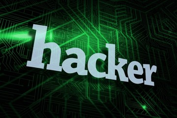 Hacker against green and black circuit board
