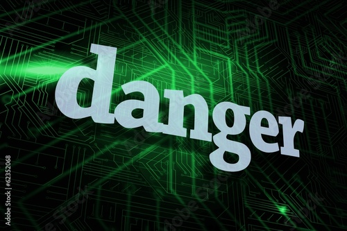 Danger against green and black circuit board