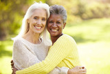 Portrait Of Two Mature Female Friends Hugging