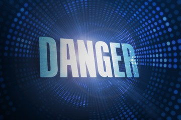 Danger against futuristic dotted blue and black background