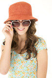 cute female model wearing orange hat and sunglasses