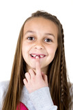 Cute girl pointing at her missing front two teeth