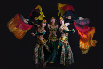 Image of young graceful oriental dance performers
