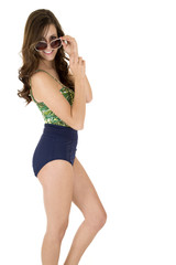 female model in playful pose wearing a swimsuit