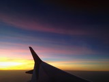 sunset with airplane wing